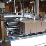 ①事業内容写真1(Nパック自動製造機械)